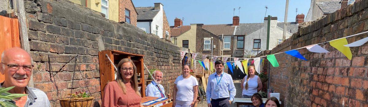 Neighbours from Litherland transform their overgrown alleyway into an amazing community garden