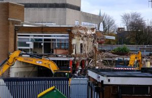 Demolition works begin near Bootle New Strand shopping centre as diggers can be seen taking down parts of a building