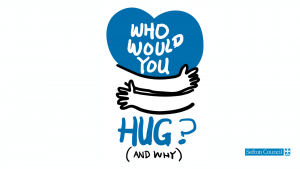 Blue heart with arms wrapped around it with the text: who would you hug and why?