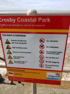 Close up of new water safety signage at Crosby beach