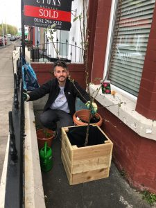 Bootle resident planting in front of their house