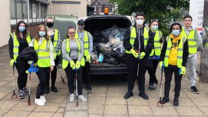 Hugh Baird College Community Action Group students with the litter they collected.