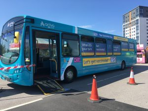 NHS COVID-19 vaccination bus parked in Bootle Asda car park