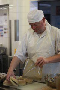 Catering staff preparing free school meals